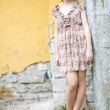 Stock Photo: Womin flowered dress waiting some friend