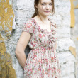 Стоковое фото: Womin flowered dress rests on wall