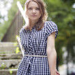 Стоковое фото: Womin checkered dress posing