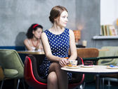 Zoomed woman in spotted dress in cafe — Stock Photo