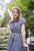 Woman in checkered dress posing — Stockfoto