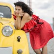 Stock Photo: Womin nice dress rely on car