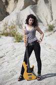 Woman placed yellow guitar on ground — Stock Photo