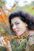Nice looking young woman hold branch — Stock Photo