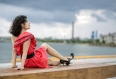 Woman in red dress leisure — Stock Photo