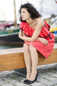 Woman in dress looking far at harbor — Stock Photo