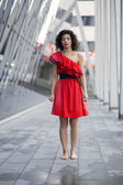 Woman in red dress stand straight — Stock Photo