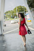 Woman in red dress looking back — Stock Photo