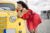 Woman in nice dress rely on car — Stock Photo