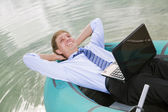 Satisfied man lay in boat and smile — Stock Photo