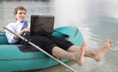 Dressed man lay over boat — Stock Photo