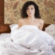 Stock Photo: Womawakened in bed after restless night