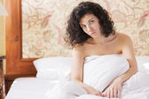 Woman under soft cover thinkink about day — Stock Photo