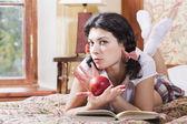 Woman in schoolgirl cross arms over apple — Stock Photo