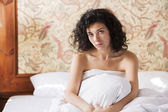 Woman sit calmly in bed after night — Stock Photo