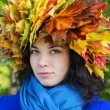 Woman with leaves on head look straight — Stock Photo