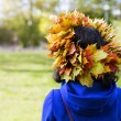 Woman with maple leaves on head — Stock Photo