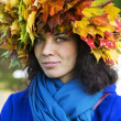 Stock Photo: Womwith leaves on head with scarf
