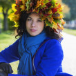 Stock Photo: Womat sunny day with leaf wreath