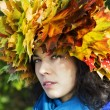 Stock Photo: Womwith leaves on head look suspiciously