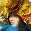 Woman with leaves on head look mysteriously — Stock Photo