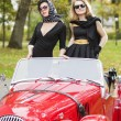 Stock Photo: Women with dark glasses with retro car