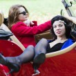 Stock Photo: Women take vocation ride on red car