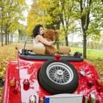 Woman keep cuddle big soft bear toy — Stock Photo #33717983