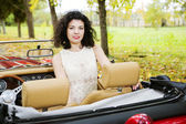 Woman at car on passanger seat — Stock fotografie