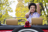 Woman with wide smile at retro car — Stock Photo