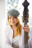 Woman with hat and strings of contrabas — Stock Photo