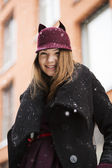 Woman at winter street with funny hat — Photo