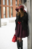 Woman at winter day with red purse — Stock Photo