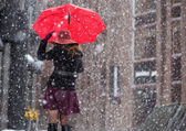 Woman with umbrella from behind — Stockfoto