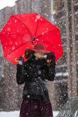 Woman with umbrella and snowfall freez — Stock Photo