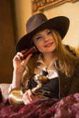 Woman in retro style costume and telephone — Stockfoto