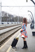Woman waiting train and look other direction — Photo
