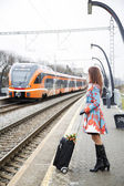 Woman at platform and train — Stock Photo