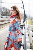 Woman posing at platform at windy day — Foto Stock