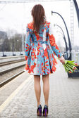 Woman at platform waiting someone with flowers — 图库照片