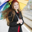 Woman with umbrella enjoy the weather — Stock Photo #47740213