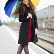 Woman with umbrella smile at camera — Stock Photo #47740375