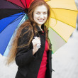 Woman posing at camera with umbrella — Stock Photo #47740395