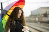 Woman with umbrella and hair over shoulder — Stock Photo