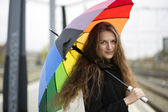 Woman with umbrella thinking about something — Stock Photo