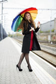 Woman with umbrella at hand welcomes observers — Stock Photo