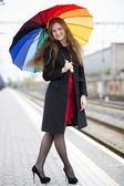 Woman with umbrella smile at camera — Stock Photo