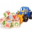 Royalty-Free Stock Photo: Wooden alphabet blocks with a toy tractor