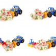 Wooden alphabet blocks with a toy tractor — Stock Photo