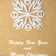 Christmas postcard with true paper snowflake — Stock Photo #33753035